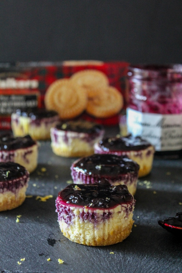 These luscious mini cheesecakes are bright and fresh and have a buttery shortbread crust. Topped with flavorful bluberry preserves, they are the perfect bite sized summer dessert!