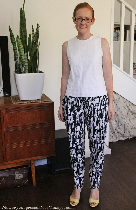 blue and white graphic print narrow leg pants
