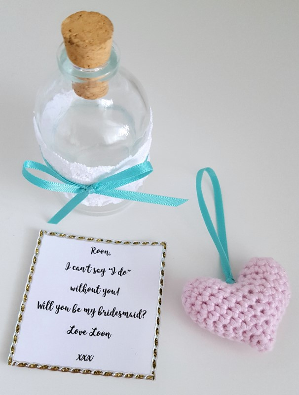 Looking for a cute way to ask your friends to be your bridesmaids?  Use this cute and easy message in a bottle idea for your bridesmaid proposal - click to find out more!