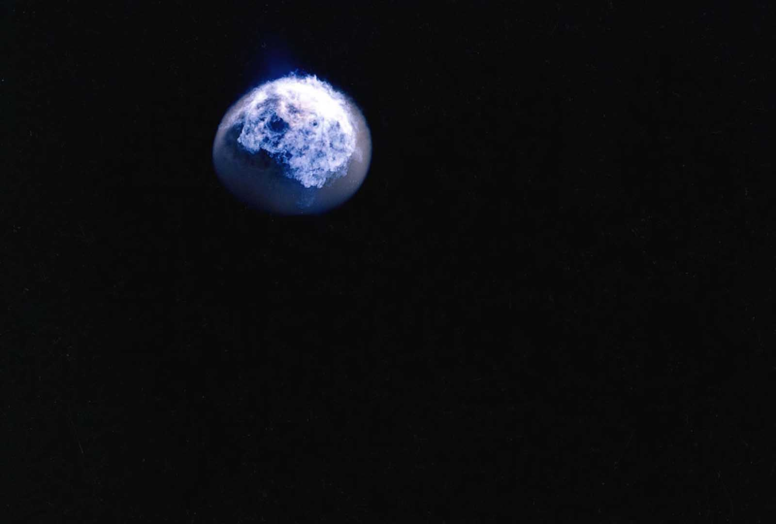 Shot during Operation Fishbowl Bluegill, this is an image of an explosion of a 400-kiloton nuclear bomb taking place in the atmosphere, 30 miles above the Pacific, as viewed from above in October 1962.