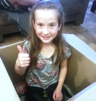 9-year old Girl in box