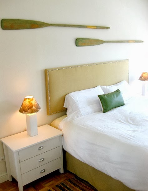 oar on wall above headboard