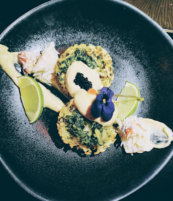 smoked cod roe with crab butter on a crumpet, topped with caviar. Iron Bloom