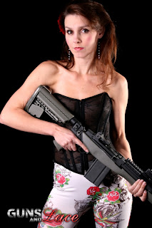 Girl in lingerie with a gun