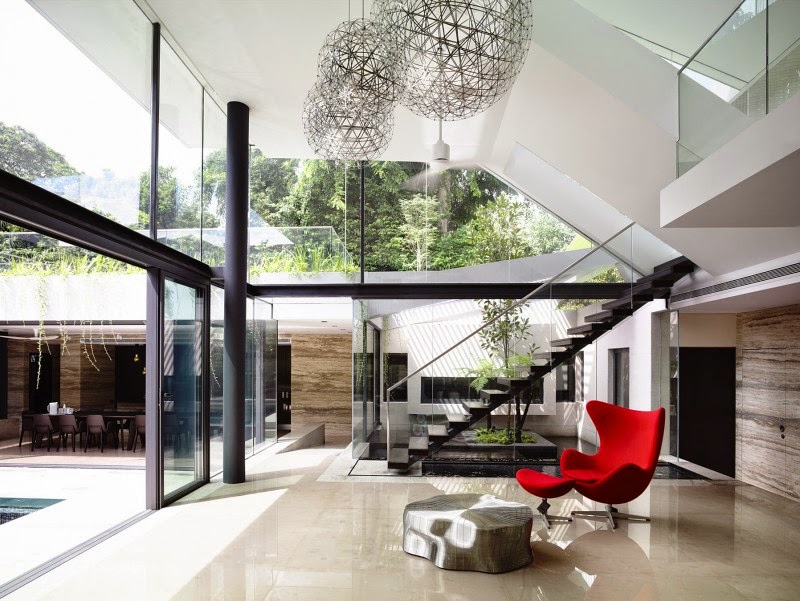 Singapore Contemporary House - interior design - a striking red color seat