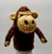 http://translate.google.es/translate?hl=es&sl=en&u=http://ohyesiknit.blogspot.com/2009/11/monkey-finger-puppet.html&prev=search