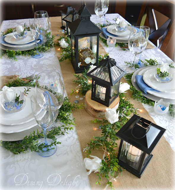Dining delight white roses black lanterns tablescape