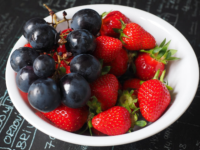Bowl of Strawberries and Purple Grapes