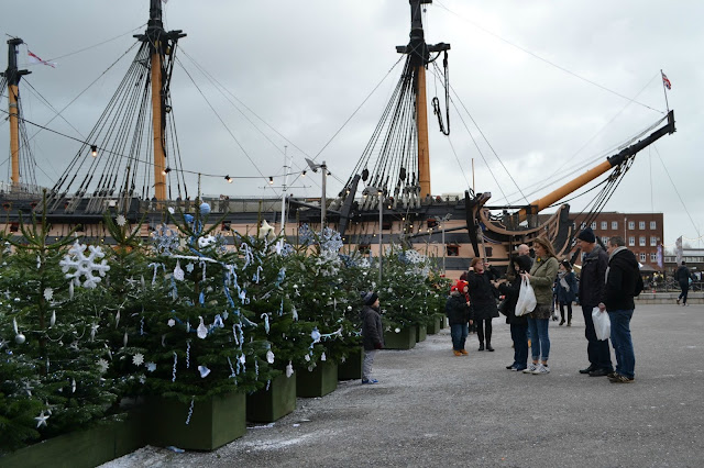 Christmas trees in front of HMS Victory