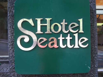 Logo for Hotel Seattle with the S very large so it looks like it should be read at the beginning of the word Hotel