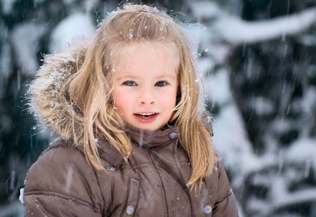 NAMC Montessori Winter holidays around the world cultural celebrations girl in snow