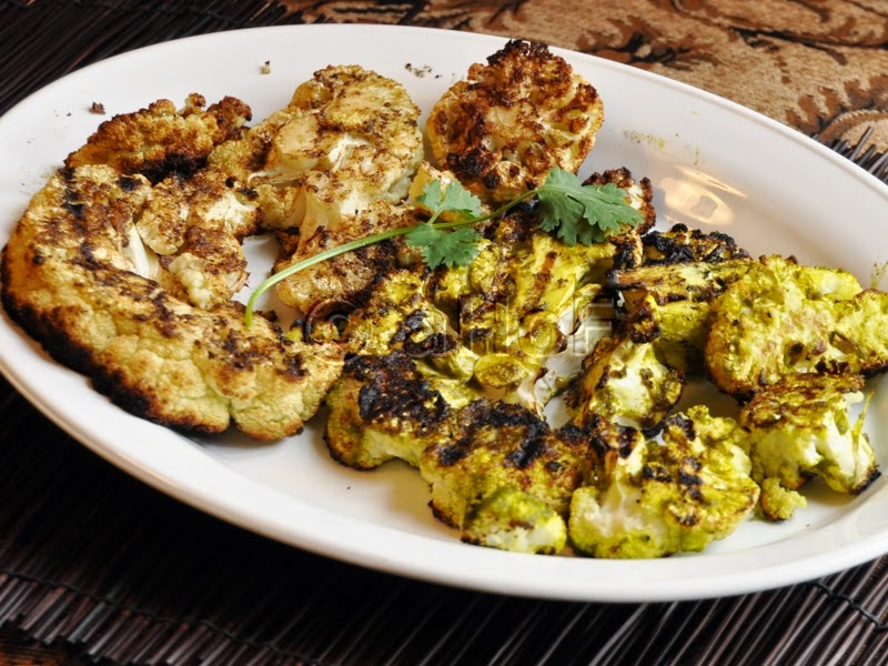 Grilled Cauliflower with Blackening Spices left; with Green Masala, right