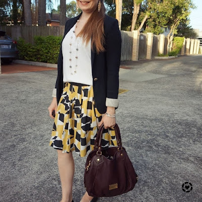 awayfromblue instagram | business casual autumn office printed pleated a-line skirt jersey blazer outfit