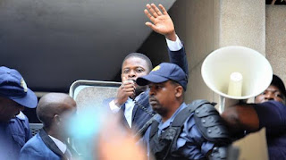Enlightened Christian Gathering Church founder Shepherd Bushiri addresses his followers outside court.