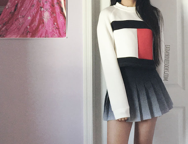 American Apparel black and white ombre grid pleated tennis skirt and Tommy Hilfiger-inspired colorblocked logo print cropped long sleeve sweatshirt from SheIn.