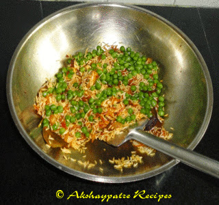 make a tempering and add rice, and green peas