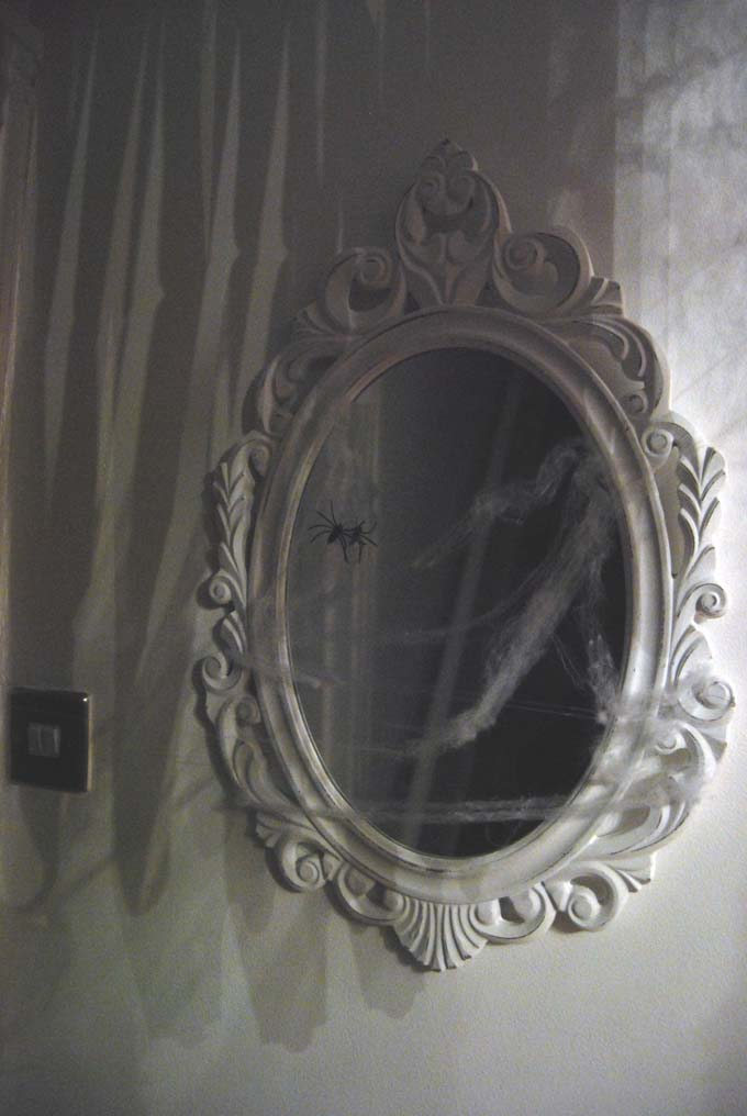 Cobweb covered mirror