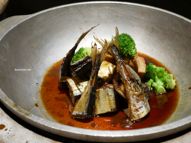 Slow cook Saury fish with soy sauce