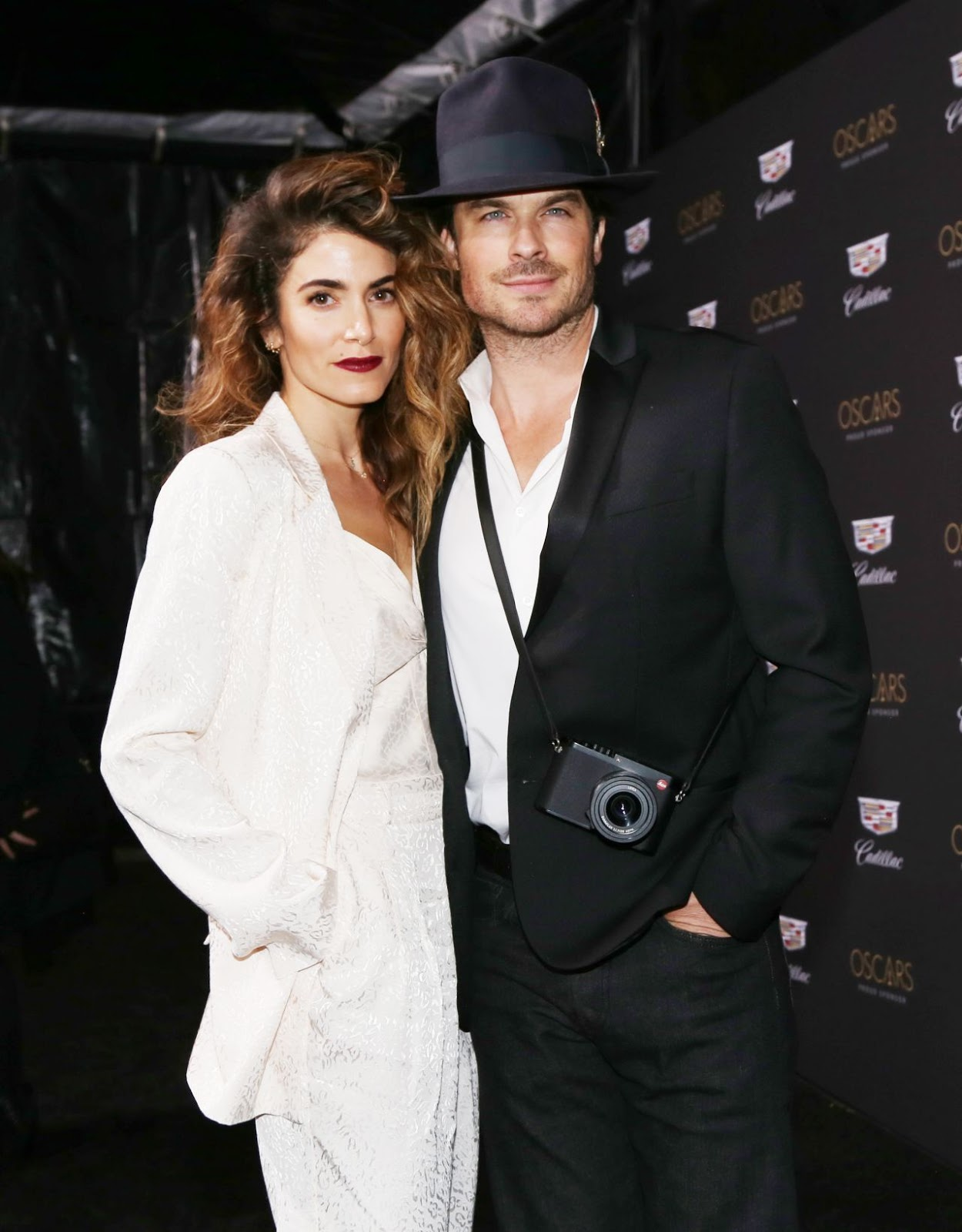 Nikki Reed dazzles in a white print suit as she joins husband Ian Somerhalder at Cadillac Oscar Party in Los Angeles
