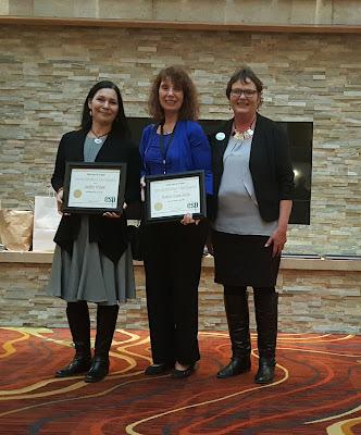 Diversity multicultural team — Rebecca Hagen-Jokela and Jennifer Garbow receiving award.