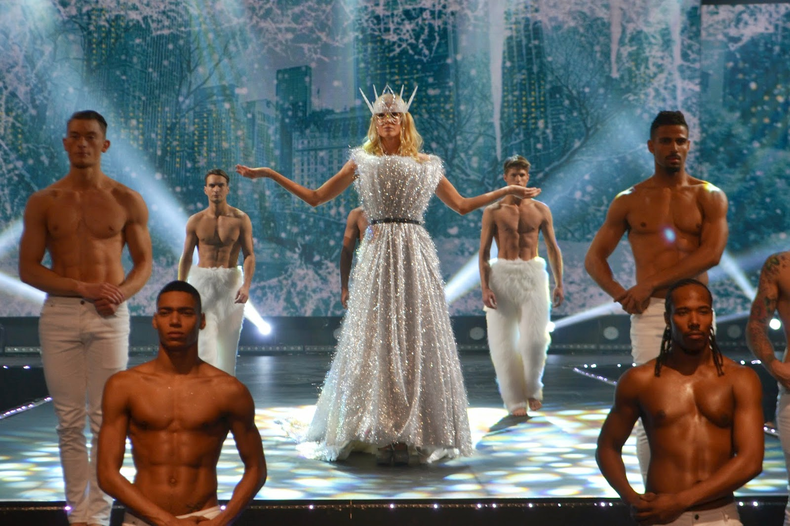 close up shot of Multiple male and female models walking across the winter themed stage