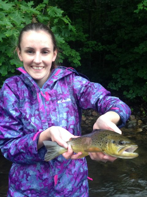 Leah's first trout on the fly rod is a beautiful brown trout