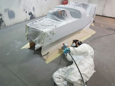 A light coat of 2k high build primer being sprayed onto my Caterham Academy car