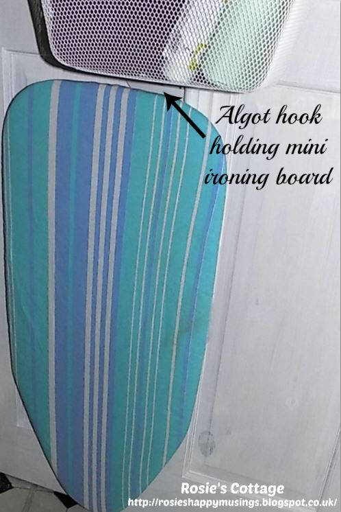 Algot triple hook holding a tabletop ironing board