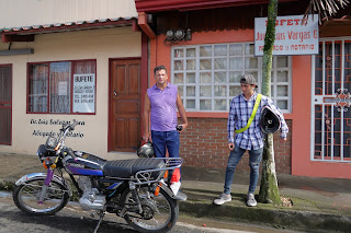Men by motorcycle in Puriscal.