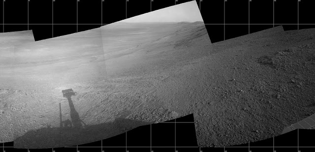 "This mosaic scene combining five images from the navigation camera (Navcam) on NASA's Mars Exploration Rover Opportunity shows a view from inside the upper end of ""Perseverance Valley"" on the inner slope of Endeavour Crater's western rim. Credit: NASA/JPL-Caltech"