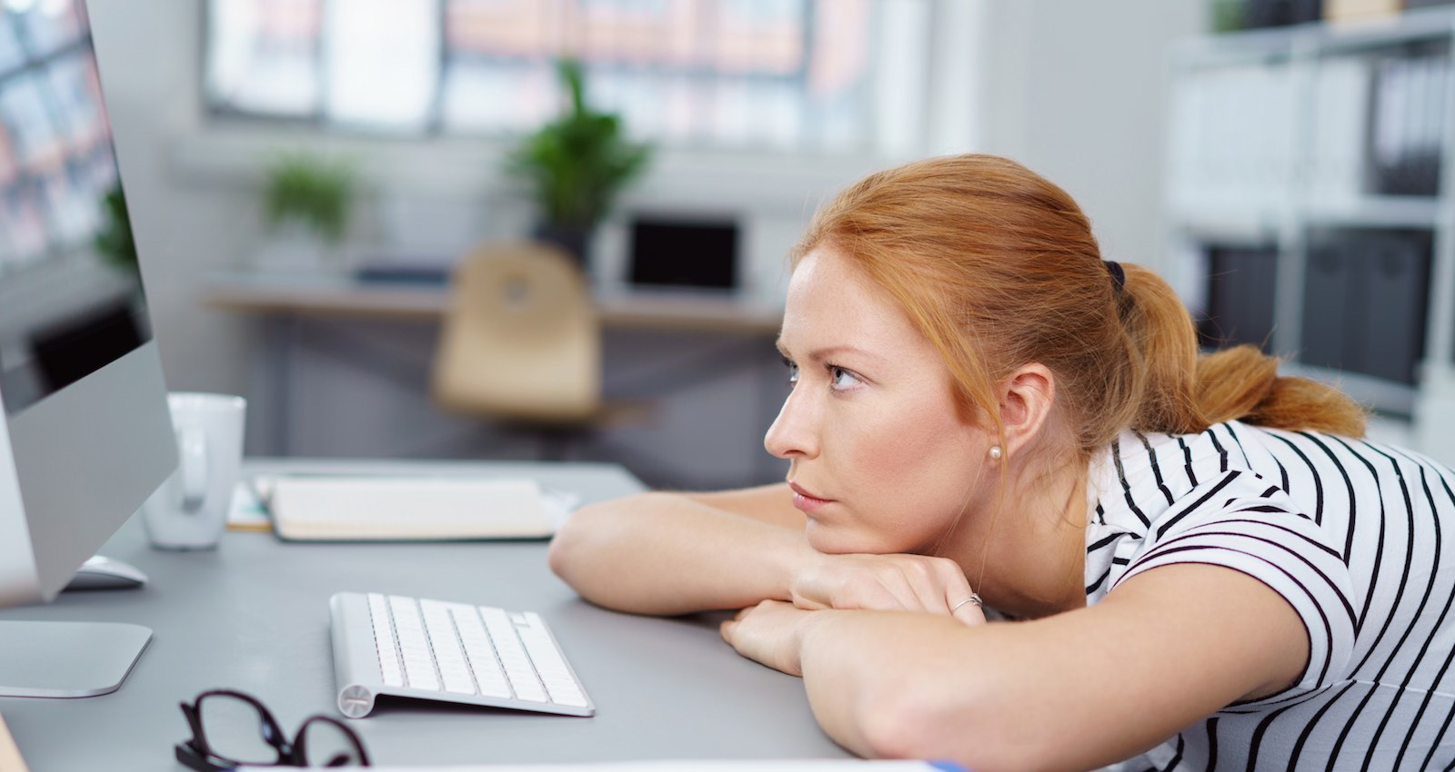 frustrated woman looking at computer screen