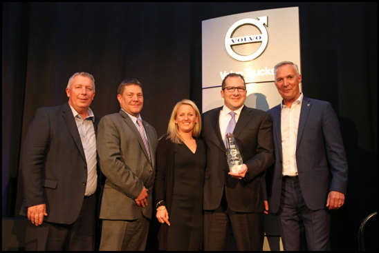 S&S Volvo dealer principal Todd Schaub (right of center) and wife Lynn Schaub (center) receive the award for the 2017 Volvo Trucks North American Dealer of the Year from (left to right) Bruce Kurtt, senior vice president of sales for Volvo Trucks North America, Chris Gossler, regional vice president northeast U.S. region and Göran Nyberg, president of Volvo Trucks North America