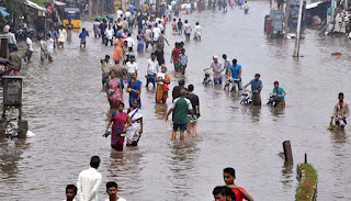 Cyclone skirts Indian coast, rain-hit Chennai keeps boats