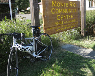 pep's bike and helmet parked next to the sign for the Monte Rio Community Center, Monte Rio, California
