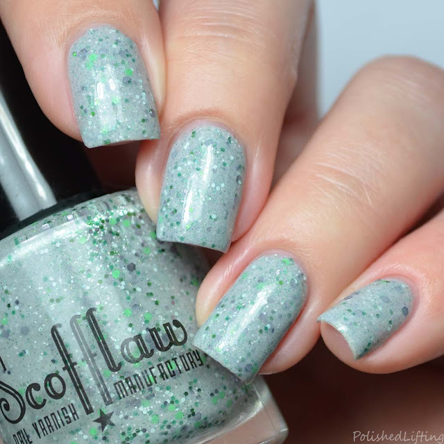 gray nail polish with green glitter