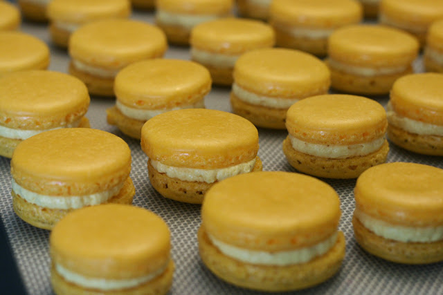 Saffron and Cardamom buttercream sandwiched between macaron shells