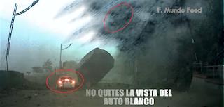 Captado por Cámaras, Piedra a punto destruye  Auto Blanco - MILAGRO