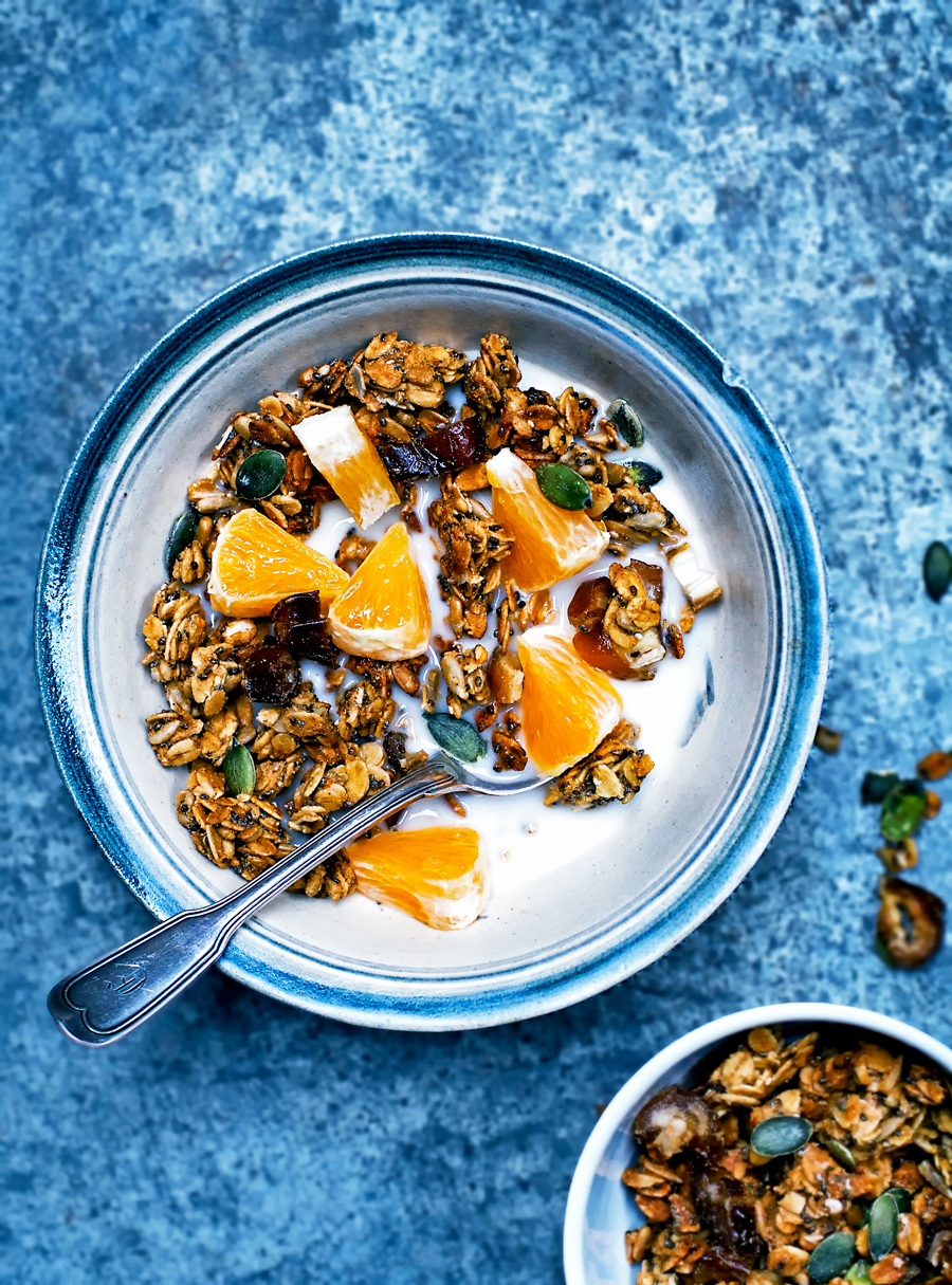 Orange Tahini Granola  Makes just over 500 grams / 3 cups  250 grams / 2 cups rolled oats 80 grams / 1/2 cup pumpkin seeds 80 grams / 1/2 cup sunflower seeds 50 grams / 1/4 cup chia seeds 1/2 teaspoon cinnamon 1/2 teaspoon cardamom* 1/2 teaspoon sumac 1/4 teaspoon sea salt 60 ml / 1/4 cup maple syrup or honey 2 tablespoons tahini 2 tablespoons olive oil** Zest and juice of a large orange (about 1/4 cup juice) 60 grams / 1/4 cup dates, chopped, and reserved***  Preheat the oven to 150C / 300F and line a large baking sheet with parchment paper. Place the oats, seeds, spices, and salt into a large bowl and stir. Add the honey, tahini, oil, zest, and orange juice, then use a wooden spoon or your hands to mix until fully combined.  Transfer the granola to the prepared baking sheet and spread into an even layer. Bake for 30-35 minutes, or until golden. It will still be slightly sticky but will become crisp as it cools.  Let the granola cool completely on the pan, then break apart and mix in the chopped dates. Transfer into a large sealed container and store at room temperature for up to a week, or a month in the refrigerator.  Notes: * Use one pod of cardamom if you're using fresh. ** I've also made this with melted coconut oil and other light-tasting oils, and it always works. I like the flavour of the olive oil but if you don't, use coconut. *** The dates tend to get a little burnt tasting if they're baked with the granola, so it's better to add them after cooking.