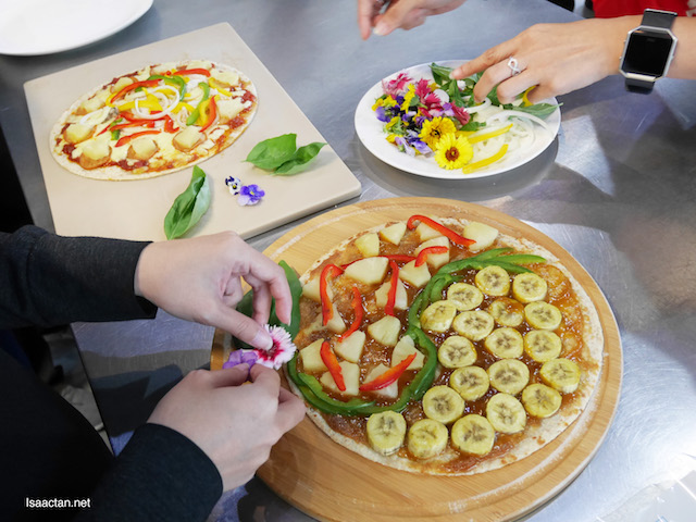 Making our own pizza is a whole lot of fun