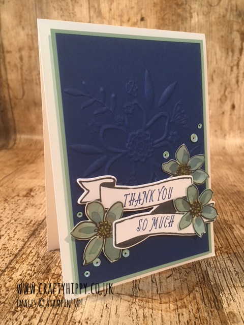 This picture shows a handmade 'Thank You' card made using the Blueberry Bushel Cardstock and the Lovely Floral Dynamic Textured Impressions Embossing Folder from Stampin' Up!