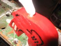 Applying glue to the bottom of the bird