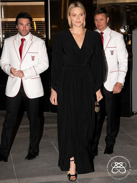 Princess Charlene wore a black dancing lady maxi wrap dress by South African fashion label Erre. Erre fashion studio