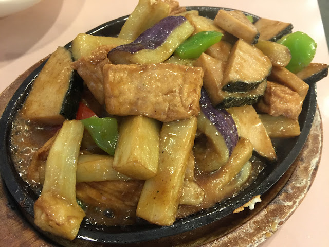 Sizzling eggplant with vegan fish steak at Veggie Lee in Hayward, California