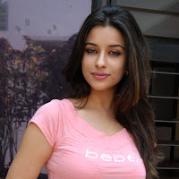 hot confident curvy Madhurima in pink top new hot photos gallery