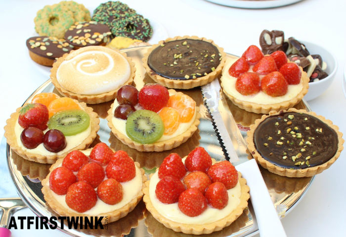 HEMA strawberry, mixed fruit, chocolate pistachio, and meringue tarts