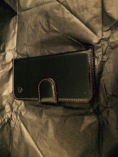 Leather phone case laid out on tissue paper