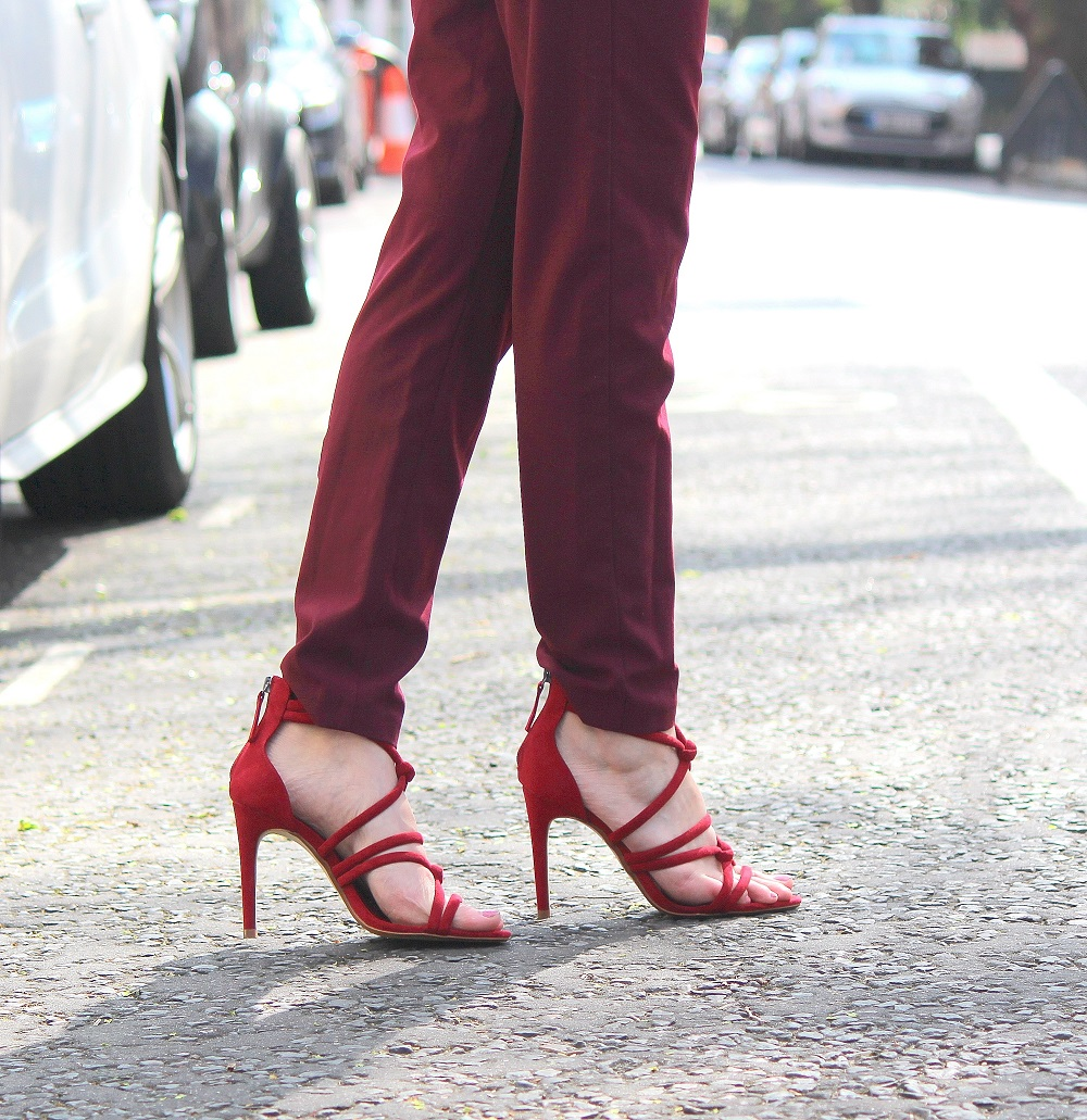 peexo fashion blogger wearing burgundy trousers and strappy heeled zara sandals