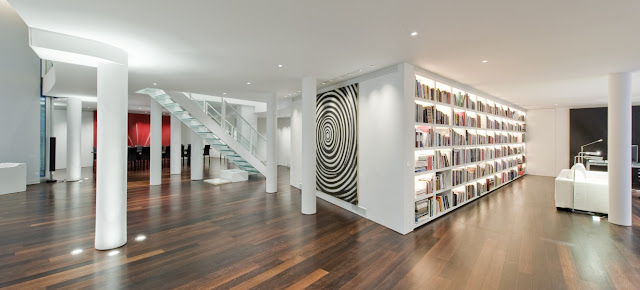 Picture of the London penthouse interiors showing the space between the library and dining room