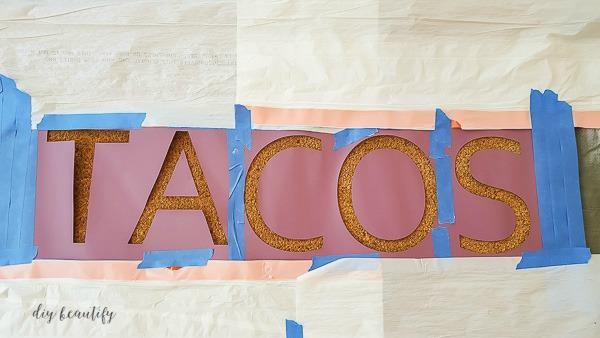 tape stencil to mat