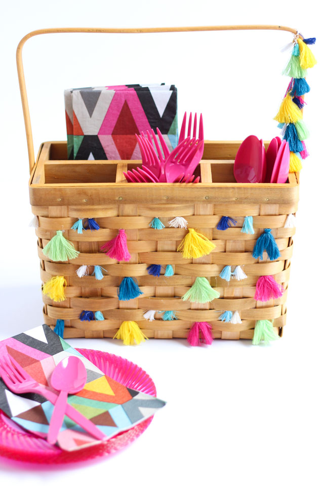 Decorate a basic picnic utensil basket with tassels for boho inspired summer entertaining!
